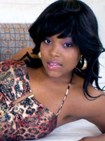 Petite black teen girl with a pink flower in her hair shows off her snatch in doggy style